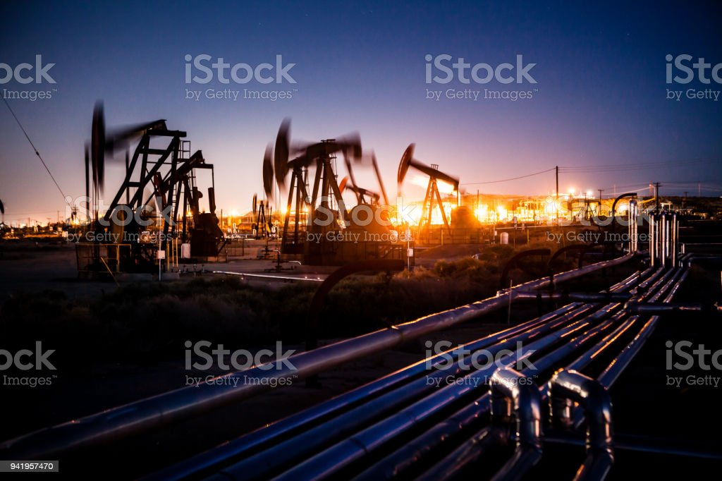 Oil pupjacks whiring at night stock photo