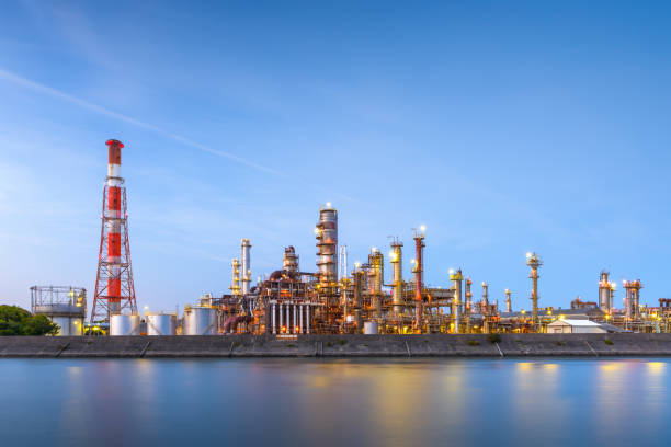 Oil refineries line a river in Yokkaichi, Japan. Oil refineries line a river in Yokkaichi, Japan. The city has been a center for the chemical industry since the 1930's. chemical plant stock pictures, royalty-free photos & images