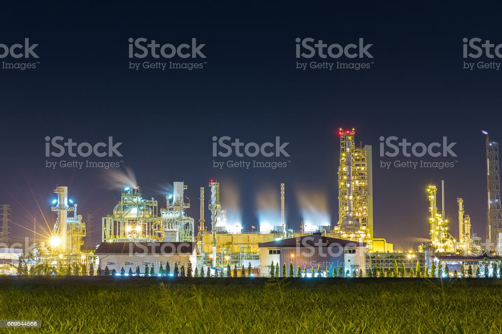 oil refinery and petrochemical plant with cooling tower in twili stock photo