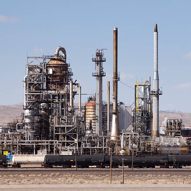 Oil refinery and tanker train stock photo