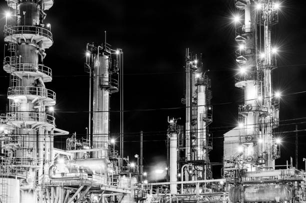 Oil refinery at night stock photo