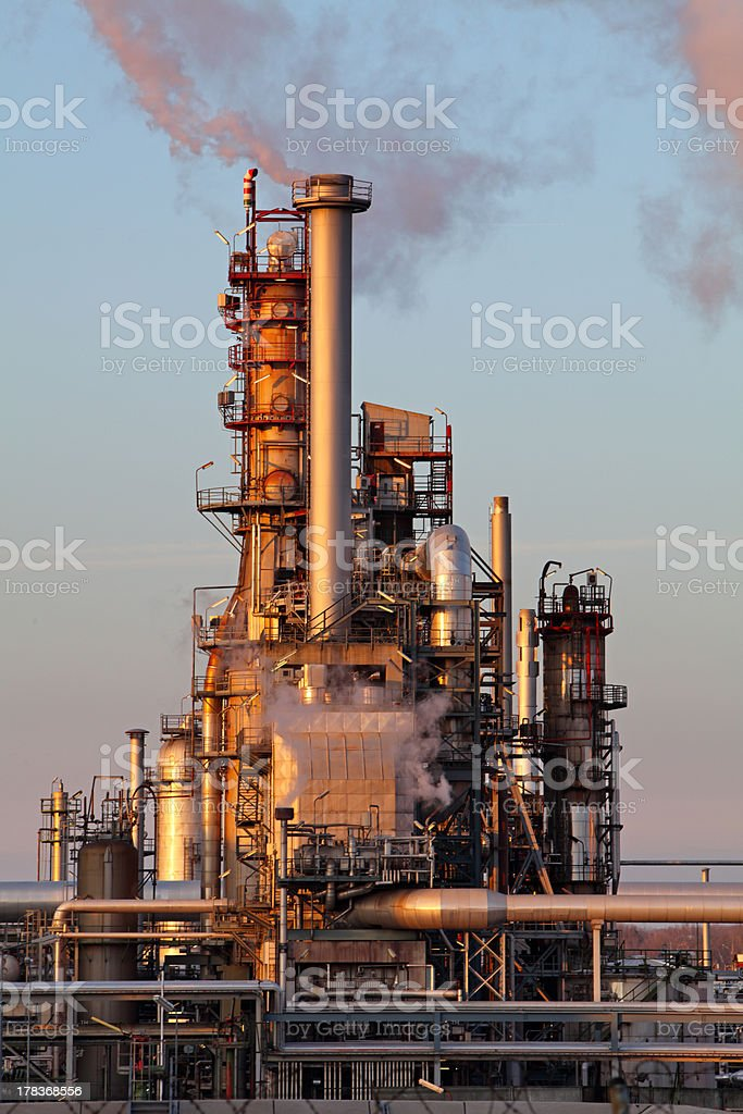 Oil refinery at sunset, petrochemical plant - factory royalty-free stock photo
