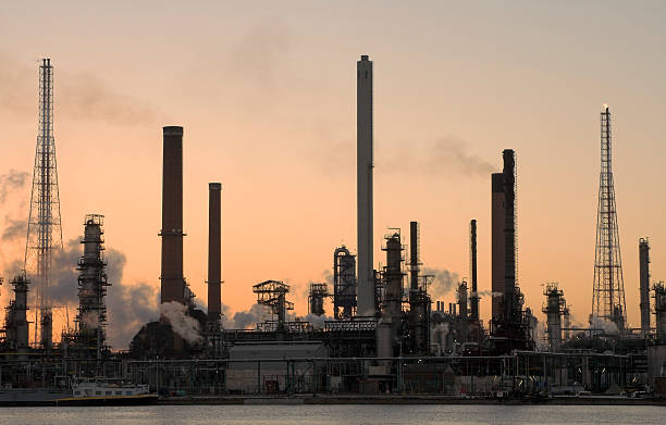 Oil refinery at sunset stock photo