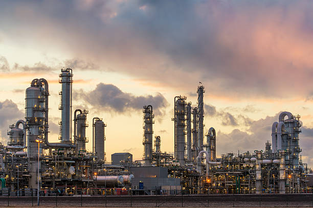 oil refinery at the harbor in rotterdam, netherlands - refinery stock photos and pictures