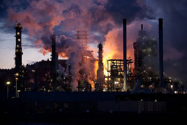 Oil refinery burning off natural gas stock photo