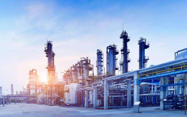 Oil Refinery, Chemical & Petrochemical Plant Oil Refinery, Chemical & Petrochemical plant at sunset. chemical plant stock pictures, royalty-free photos & images