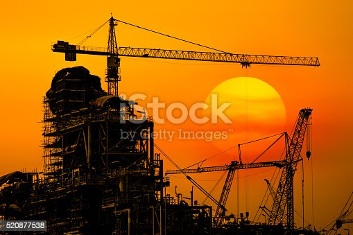 Oil refinery construction in silhouette, Industrial Oil refinery in building on sunset background at industrial plants