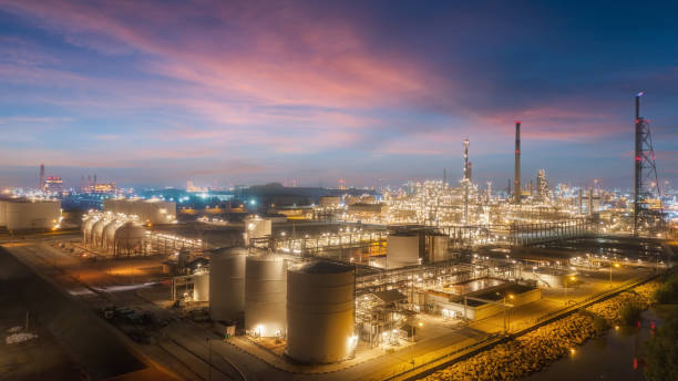 Oil refinery factory with beautiful sky at dusk for energy or gas industry or transportation background. Oil refinery factory with beautiful sky at dusk for energy or gas industry or transportation background. chemical plant stock pictures, royalty-free photos & images