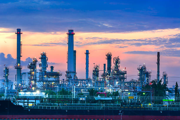 oil refinery in morning - refinery stock photos and pictures