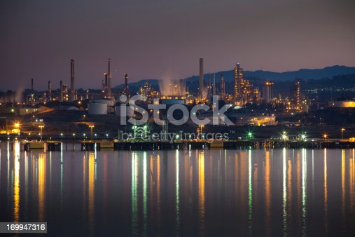 A large oil refinery and chemical plant on the Carquinez Strait in the San Francisco Bay Area is light up at night.