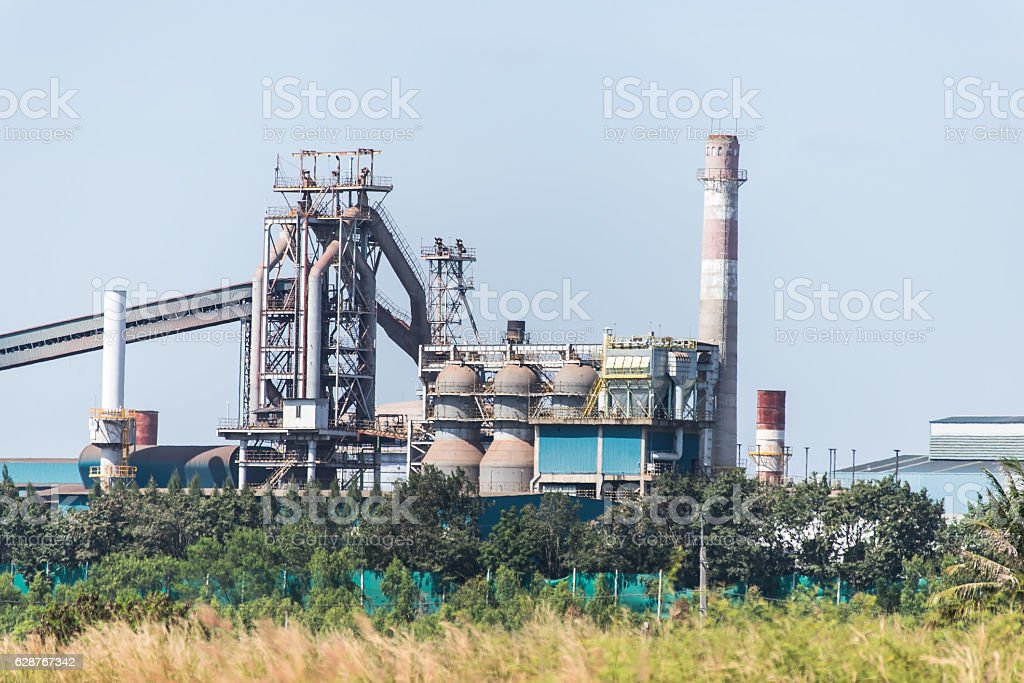Oil refinery industry at sunset - factory - petrochemical plant stock photo