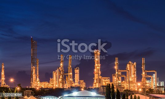 Big oil tanks in a refinery with treatment pond at industrial plants