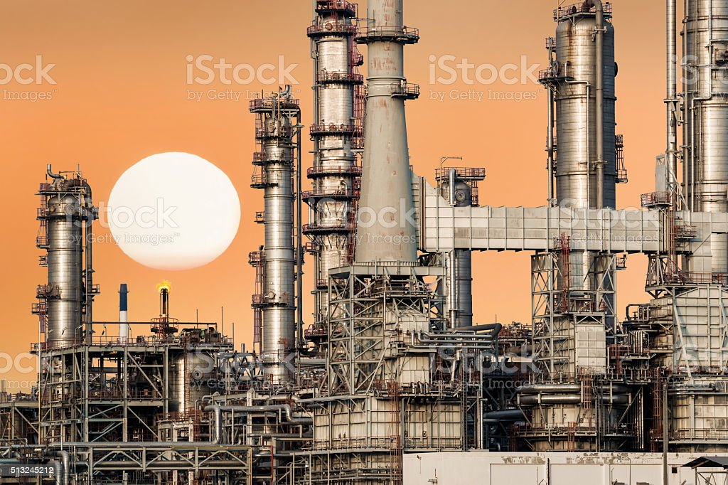 Oil refinery isolated with sunset. stock photo