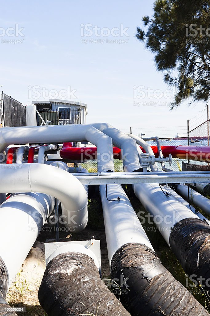 Oil refinery pipelines, copy space royalty-free stock photo