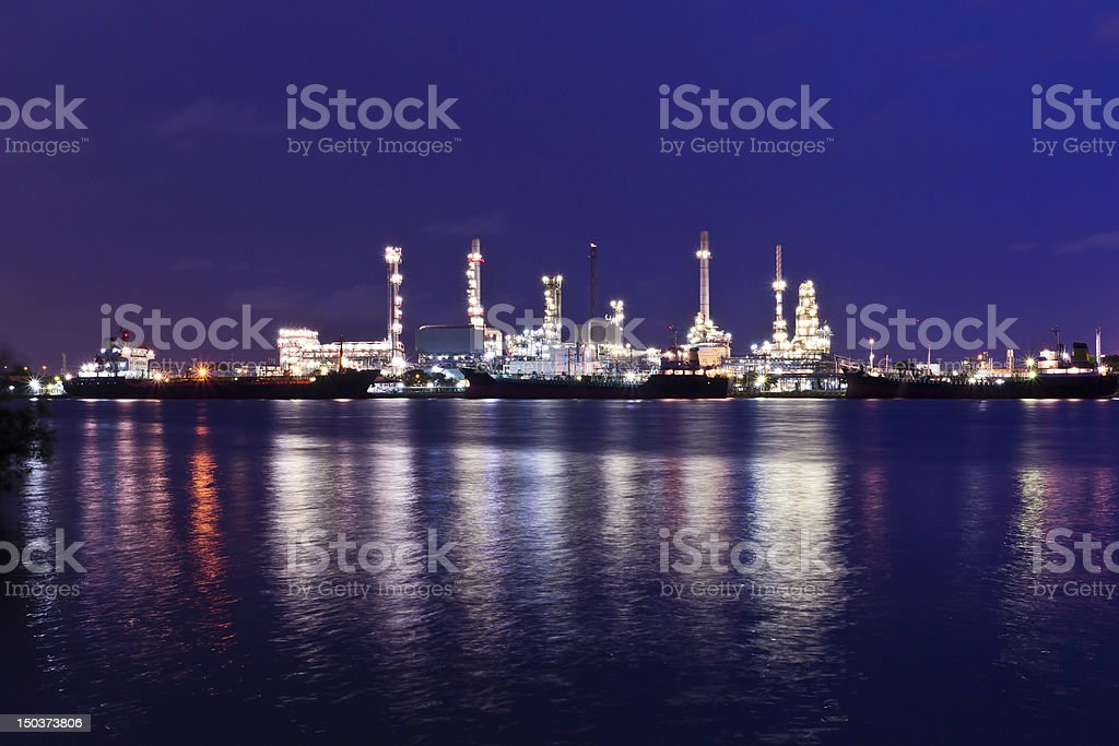 Oil refinery plant along river in Bangkok royalty-free stock photo