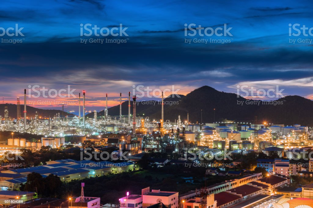 Oil refinery plant and cityscape at twilight stock photo