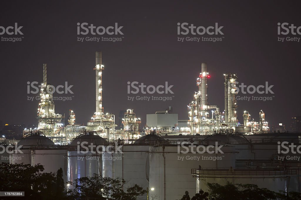 Oil refinery plant and silo at night royalty-free stock photo