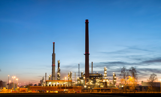 Petrolchemical plant and refinery complex at dusk, Germany, panoramic image created from 5 long exposures.