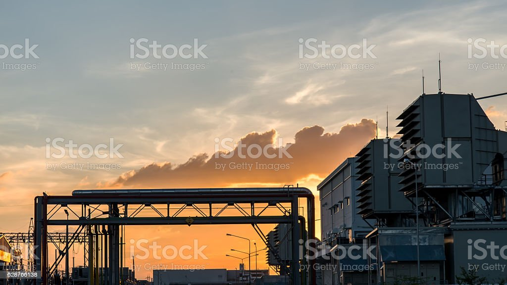 Oil refinery plant at sunrise with sky background stock photo