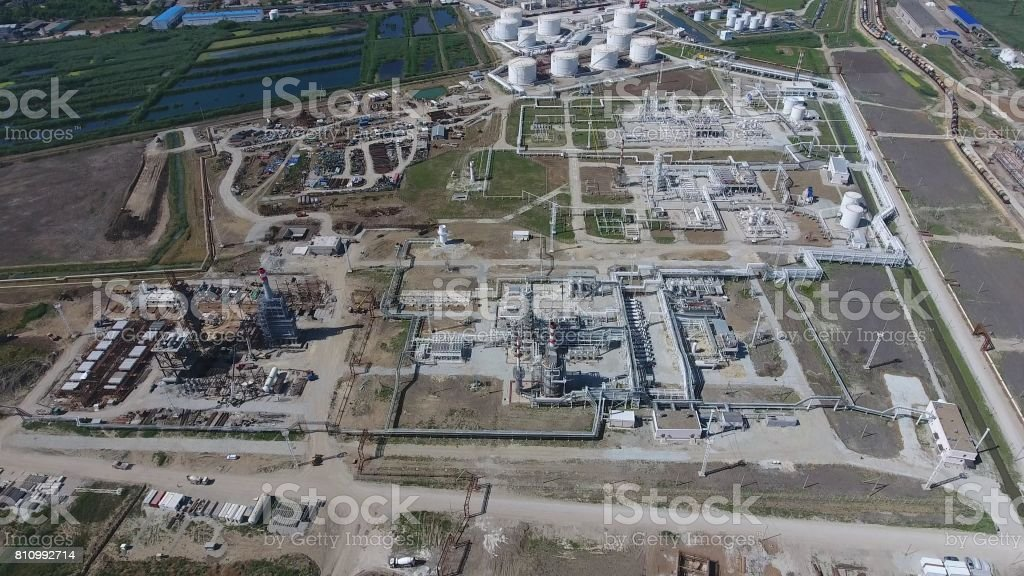 Oil refinery plant for primary and deep oil refining. Equipment and tanks in the oil refinery. Rectification and vacuum equipment. stock photo