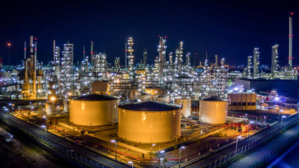oil refinery plant from bird eye view - refinery stock photos and pictures
