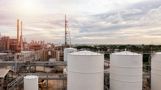 Oil refinery plant from industry zone, Aerial view oil and gas petrochemical industrial, Refinery plant chemical factory oil storage tank and pipeline steel.