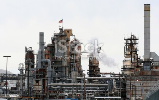 Petroleum refinery with an American flag.