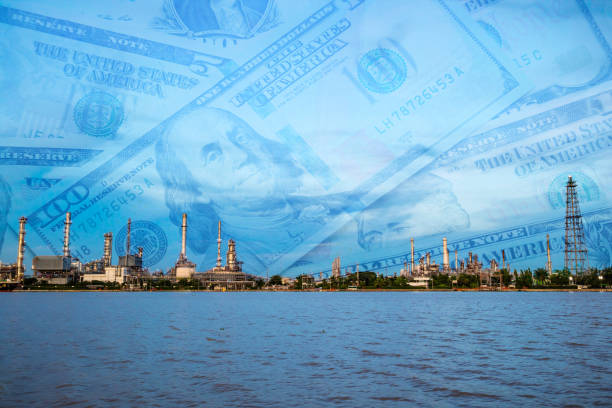 Oil refinery plant with dollar cash background. Industrial business and economy concept stock photo