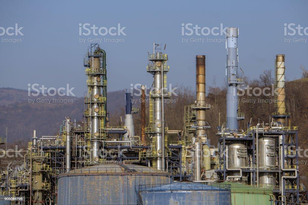oil refinery smoking chimney detail stock photo