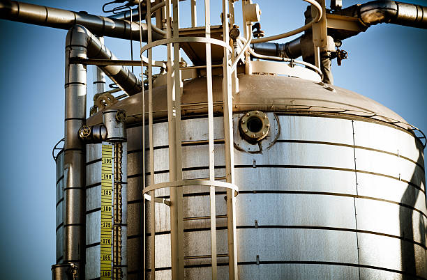 oil refinery storage tank - halbergman stock pictures, royalty-free photos & images