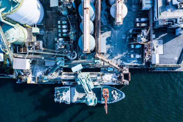 Oil refinery storage units with tanker ships stock photo