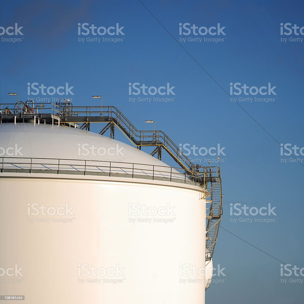 Oil Refinery Tank Against Blue Sky royalty-free stock photo