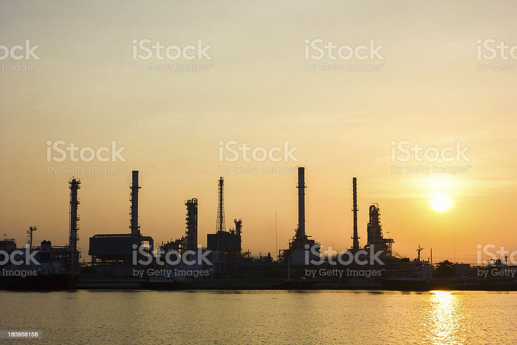 Oil refinery view with Sunrise royalty-free stock photo