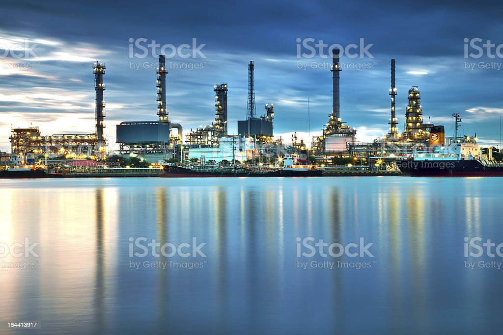 Oil refinery with reflection, petrochemical plant stock photo