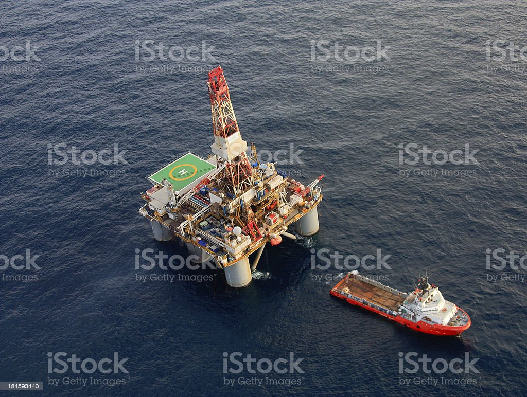 Oil Rig and Support Ship stock photo