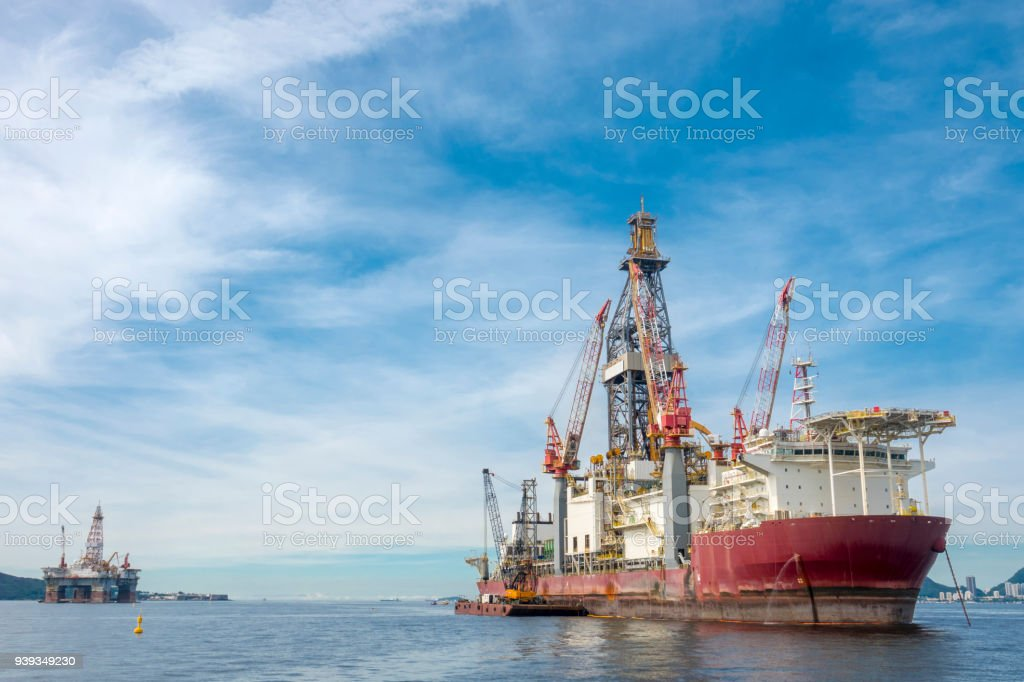 Oil rig and support vessel on offshore area stock photo