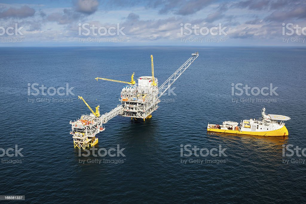 Oil Rig and Support Vessel. stock photo