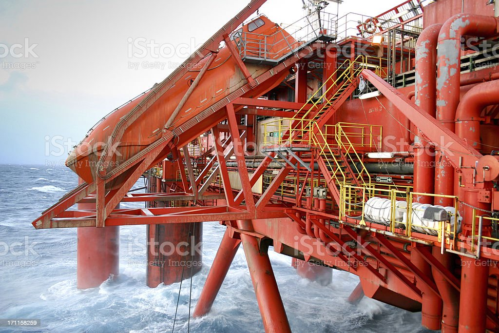 oil rig at sea with lifeboat royalty-free stock photo