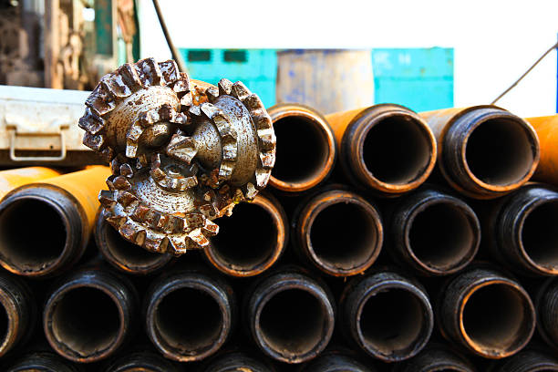 oil rig drill bit with drilling pipe oil rig drill bit with drilling pipe, tricone bit drill bit stock pictures, royalty-free photos & images