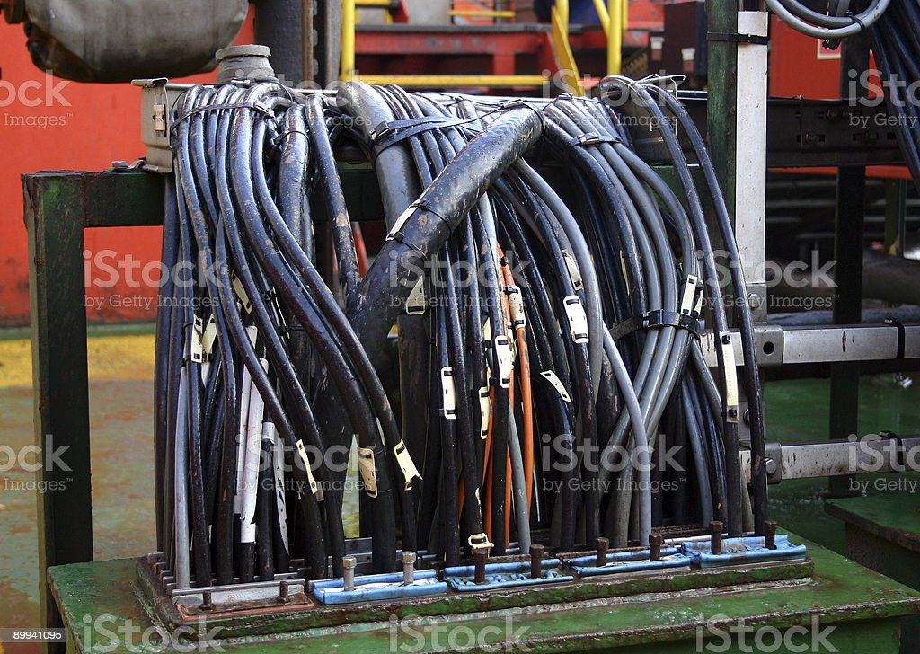 oil rig electric cables passing through a deck stock photo