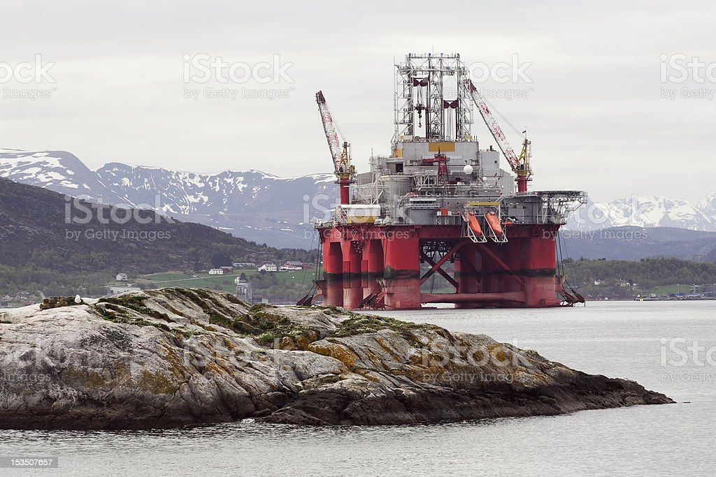 Oil rig in fjord landscape royalty-free stock photo