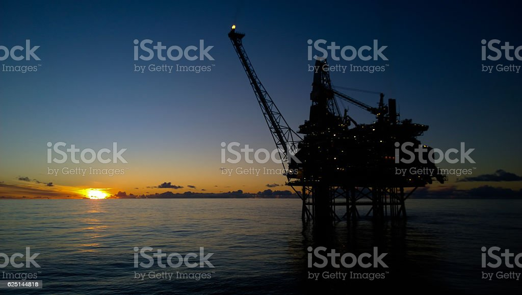Oil rig in sunset stock photo