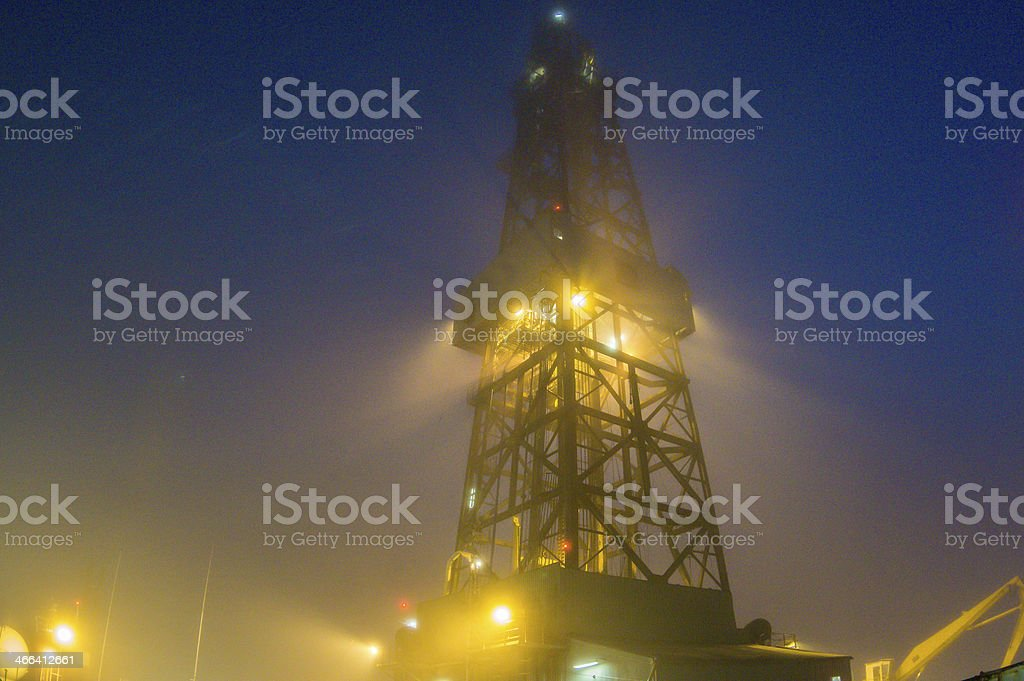 oil rig platform on a foggy night at sea royalty-free stock photo