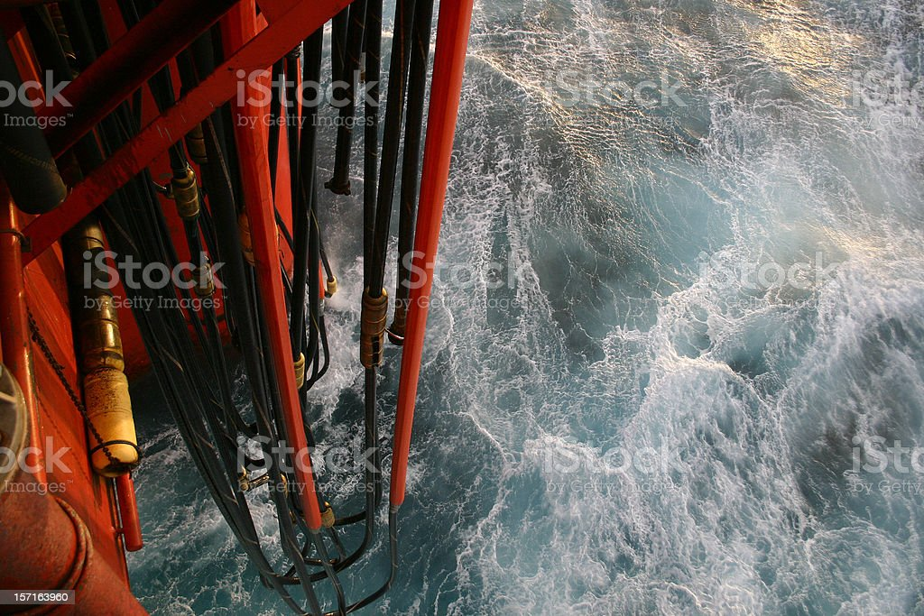 oil rig platform view down to sea and pontoon hoses royalty-free stock photo