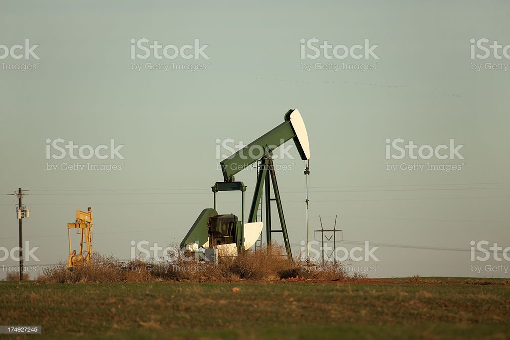 Oil rig pumps in Texas fields copy space stock photo