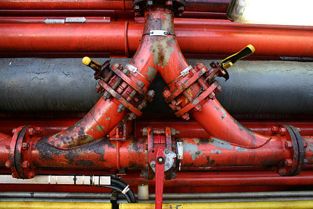oil rig rusty 3 way pipe valves - pillar drill stock photos and pictures