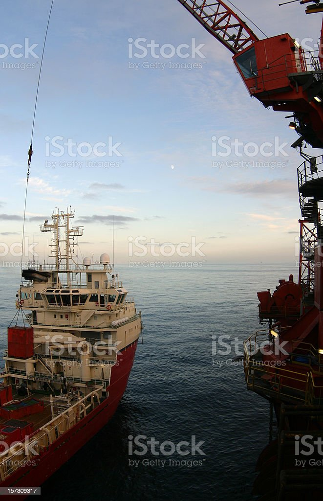 oil rig supply boat at sea stock photo