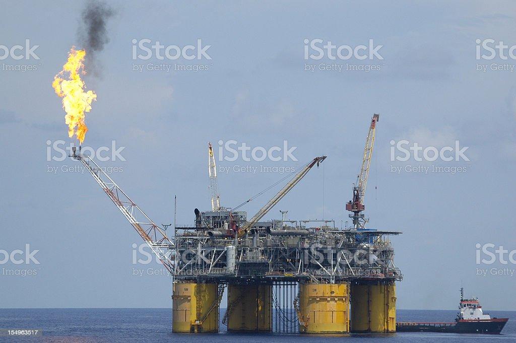 A tension-leg type oil production platform burns off unrecoverable...