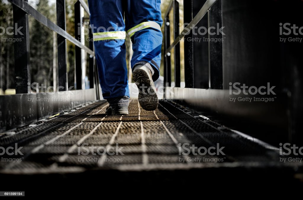 Oil Rig Worker on Walkway stock photo