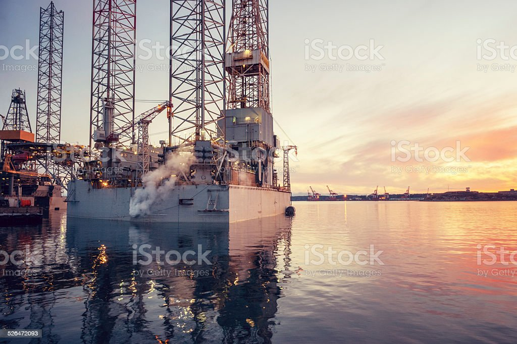 Oil Rigs at Sunset stock photo